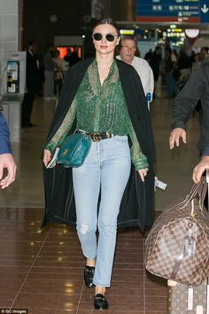Miranda Kerr wearing Louis Vuitton Keepall 50 Damier Ebene, Emilio Pucci Marquise Bag in Teal, Linda Farrow 479 Sunglasses, Gucci Clover Belt with Double G Buckle, Gucci Jordaan Leather Loafer, Louis Vuitton Passport Cover, Re/Done Relaxed Straight and Louis Vuitton Pegase Legere 55 Carry on