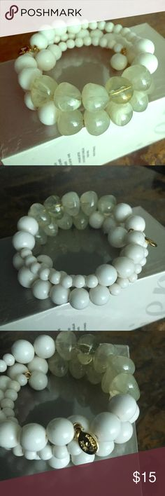Robert Rose stone & white beads stretch bracelet Brand new never worn Robert Rose White beads with gray stones on a stretch material with his tag with his name on bracelet !!! 😉 never worn made in China Robert rose Jewelry Bracelets