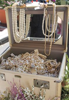 vintage make-up case filled with pearls, pearls, and more pearls