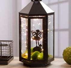 This Lighted Fairy Garden Lantern will add a twinkle to your fairy fantasy world! Make this craft in a few simple steps to spruce up your garden!