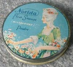 """Rare Norida Fleur Savage Miniature Complexion Powder Tin With Beautiful Lady Graphics ~ Very good condition; full of powder; measures 1-5/8"""" x 1/4""""."""