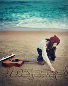 music.....if not at the beach you could use chalk on concrete! Love this idea for a photo!