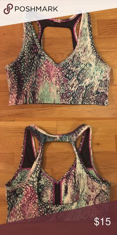 Fabletics multicolored sports bra Like new condition, only wore it 3 times. V neck front and open back, fun colors look great under a solid tank or alone! Tag cut out in the back but it is a size small. Fabletics Intimates & Sleepwear Bras