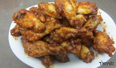 "America's favorite wings - now in your kitchen! Buffalo wings are named after the sauce which originates from Buffalo County in New York (that's what I'm told!). They are spicy, sour and sweet all in one! Buffalo wings are very popular during the Super Bowl - but also with a game of basketball, football or just as a great snack - these are just the most delicious wings! Originally, a hot sauce called ""Frank's hot sauce"" is used when making this dish. I have made my own type of ""hot sauce""…"