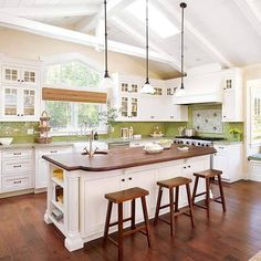 Love this kitchen. Great island with unique bar stools!