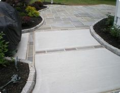 Here is another unique design for the backyard.  A wonderful combination of concrete with paver inlays and stone.