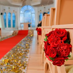 Beautiful red blooms line the aisle of Disney's Wedding Pavilion