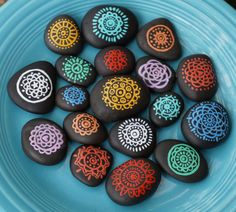 This is an set of 20 black hand-painted rocks featuring a lace-like mandala in multiple colors. They are perfect for an eco-friendly table confetti that can be reused, or you can give them to your guests as a party favor to commemorate your event.  Each stone design is different! All measure from approximately 1 to 2 in diameter. They are painted with an enamel paint that can endure most weather conditions. They can be kept in the house or put outside in the garden.  If you are looking for a…