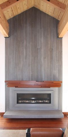wide format fireplace with concrete surround facing and solid laminated solid sapele mantle piece
