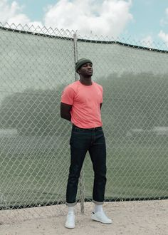 Men's Hot Pink Crew-neck T-shirt, Navy Jeans, White Leather Low Top Sneakers, Dark Green Beanie Portrait Photography Men, Photography Poses For Men, Photography Styles, Male Models Poses, Male Poses, Urban Fashion, Mens Fashion, Street Fashion, Black Men's Fashion