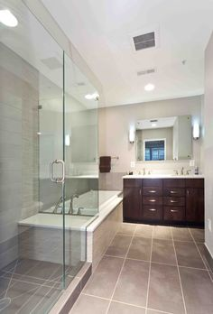The new bathroom trend? Smaller bathtub, bigger shower. Designed by Foster Remodeling Solutions.