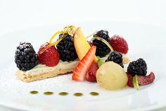 Yuzu lemon meringue with blackberries and creme anglaise.