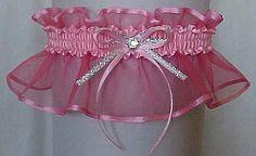 Get personal. PINK Sheer Elegance Organza Garter with silver accent bow and crystal rhinestone eye by Custom Accessories Garters LLC. Wedding Garter – Bridal Garter – Prom Garter – Fashion Garter. Visit: www.garters.com/page42b.htm
