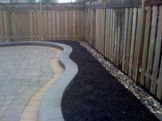 Landscaping with river rocks along fence lines allows you to not have to pull weeds.