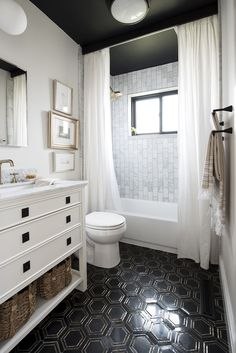 Black Hex Floor Tile and Marble Shower with Ceiling Mounted Curtains black ceiling, celing mount curtains! Bathroom Floor Tiles, Bathroom Renos, Bathroom Interior, Small Bathroom, Black Bathroom Floor, Bling Bathroom, Marble Showers, Black Ceiling, Bath Remodel