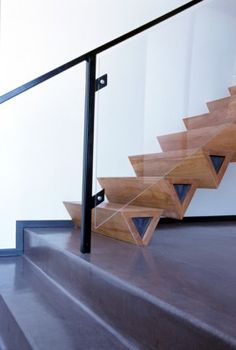 This flight of stairs has unusual triangular timber treads