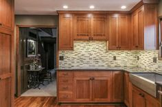 Quarter sawn white oak cabinets, Porto bello Amber 12x12 mosaic tile, Cambria Blackwood quartz countertops, Jenn air downdraft and cooktop, stainless steel farm sink