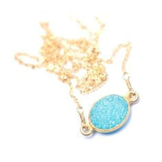 Aqua Druzy Necklace - oh boy does gold and light blue capture my eye. The delicate chain can drizzle over your collar bones and the stone in the middle is like a chip of iceberg and no metal work surrounding it to distract you from its icy beauty.