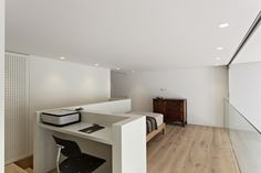 Flooring and Sofas Bed White Table Work Framed and Glass Panels Completed the Room