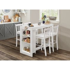 Create a serene and inviting spot to eat in a small area with this Amandes Counter Height Dining Table with Shelving. Its economic scale doesn't take away from its style, comfort, and function.