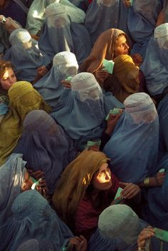 """"""" Abbas AFGHANISTAN. Kabul. 2001. Women, dressed in burquahs, desperate to receive food distributed by the United Nations after the Taliban have left the capita """""""