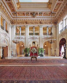 "The Breakers | Cornelius Vanderbilt II's ""cottage,"" Newport, RI. Pictured: The Great Hall modeled by Richard Morris Hunt after the 16th-century Renaissance palazzos of northern Italy. Rug is Kurdish from Turkey. Four bronze chandeliers and eight free standing cast bronze candelabra."