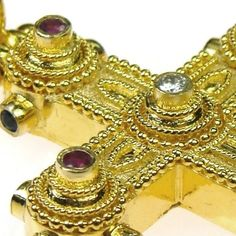 Damaskos Ruby and Diamond Western Cross. 18k Gold, Sapphires, Rubies and a Diamond.Hand crafted detail by our jewelry designers makes the work stand out. Greek jewelry at www.athenas-treasures.com