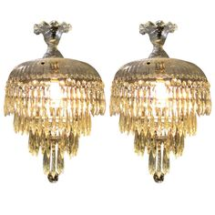 Pair of Five Tier Crystal and Glass Chandeliers | From a unique collection of antique and modern chandeliers and pendants  at https://www.1stdibs.com/furniture/lighting/chandeliers-pendant-lights/