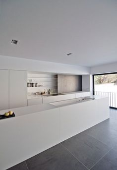 Light grey floor tiles, white kitchen