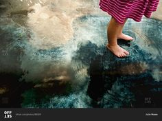 Girl's feet on reflective puddle   child, kid, young, girl, female, one person, person, caucasian, stand, puddle, water, barefoot, reflection, cloud, nature, sky, still, summer, ground, high angle view, low section, ripple, surface, outdoor, outside, concrete, pavement