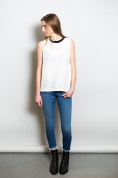 The Novel woven tank top from Just Female is sleek and sporty with a boxy fit. Features a ribbed contrast black collar, darted bodice and semi-sheer shantung...