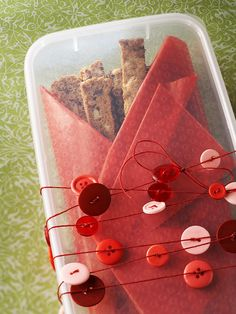 Decorate a treat box using homemade garland from string and buttons. More super quick gifts: http://www.bhg.com/crafts/easy/30-minute-projects/super-quick-gifts-to-make/#page=10
