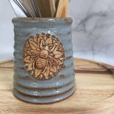 There's a whole new collection of #bee utensil holders and or vases in the shop now and ready to ship. Shop link in profile or QueenBeePottery.Com #bees #beee #beekeeping #beelovers #beelovely #thatsdarling #apiary #beelife #beehive #beelove...