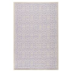 Wool rug with a geometric motif. Hand-tufted in India.  Product: RugConstruction Material: WoolColor...