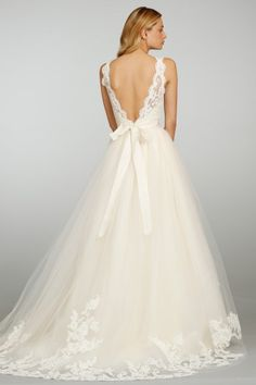 Tulle gown with Alencon lace bodice, bateau neckline, v-back, and chapel train.