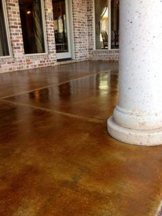 Beautiful stained patio by Concrete Expressions