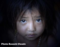 I saw her in a small, very poor hill village in LAOS...sitting in a half dark room and telling me through her eyes, that she needs more care and love...
