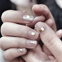 Love this subtle metallic nail art on bare nails