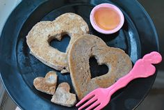 Heart-shaped pancakes made with strawberries/honey