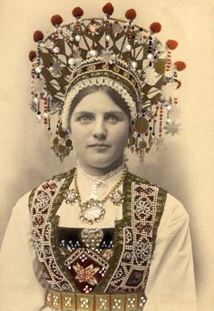 Norwegian bride wearing a traditional folk costume with a bridal crown. The bridal crown has small metal discs and beads hanging from it which produce a melodic tinkling — according to legend, this is to ward off evil spirits from the bride. Portraits Victoriens, Bridal Crown, Folk Costume, Traditional Dresses, Beautiful Beaches, Headpiece, Wedding Headdress, Vintage Photos, Textiles