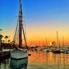 Sunset at Barcelona harbor... Barcelona is a beautiful & friendly town and the beaches are great. At one time you could rent spirited horses to ride in the surf & sand.