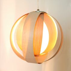 Wood Veneer strips into a pendant lamp. Secured at top with bolts and hollow threaded lamp parts