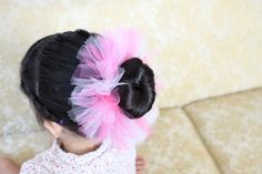 Ballerina Bun Holder. Made exactly like a tie tutu but obviously on a much smaller scale.  They used pinking shears to cut the ends of the tulle, i really like the look it gives it