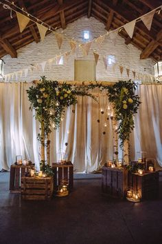 Aisle Ceremony Backdrop Arbour Candles Crates Branches Flowers Bunting Magical Winter Rustic Wonderland Wedding http://hayleybaxterphotography.com/