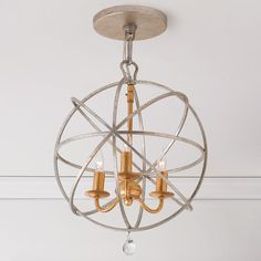 "Up at the ceiling or hung down as a mini chandelier, this globe cage pendant light adds a graphic accent in matte White, English Bronze, aged Silver, or Silver and Gold combo (exclusive to Shades of Light). Optional crystal ball accent hangs from the bottom. 3x60 watts (candle sockets). (16.5""Hx12.5""W) Includes an 8"" rod and 72"" chain."
