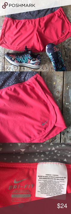 Nike Dri-Fit Running Shorts in Coral/Grey Color Sure cute, lightweight and comfortable running shorts by Nike, DRI-FIT style. Nice coral (pink?) color with gray and white print waist band. Has zip back pocket, two small interior slip pockets, adjustable draw strings inside, matching coral panty liner. In great condition! Super soft and breezy material! Size Medium 🎈No holds/trades 🎈No transactions outside Poshmark 🎈No lowball offers, open to reasonable ones 🎈Please use Offer button to…