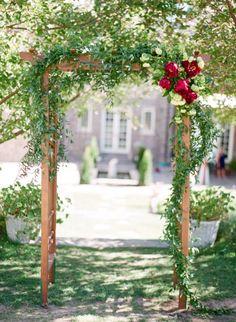 Greenery Garland Ceremony Arch   Connie Whitlock   http://heyweddinglady.com/peony-lace-outdoor-summer-wedding/