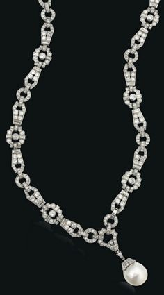 AN ART DECO DIAMOND SAUTOIR, RETAILED BY CARTIER, CIRCA 1930. The articulated millegrain-set chain, composed of a series of openwork pavé-set brilliant and baguette-cut diamond geometric panels, suspending a later cultured pearl pendant, may also be worn as four bracelets, 74.5cm, with French assay marks for platinum, numbered. #ArtDeco #sautoir
