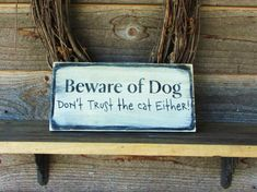 Funny Pet sign Beware of dog, funny dog sign, funny cat sign, wood sign, rustic sign, dont trust the cat either Made of wood, and measures 12 X 7 comes ready to hang with hanger on the back. CHOOSE COLORS AT CHECK OUT Unless requested otherwise, the lettering on the base colors