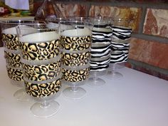 Animal print duct tape in leopard and zebra patterns can be cut in half and wrapped around plastic cups or glasses for jungle themed drinks. #party #diy #decorideas